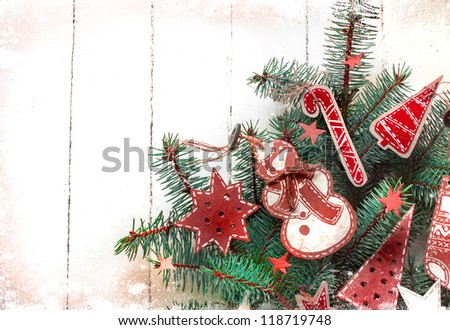 Christmas decoration over grunge background/vintage paper christmas decoration on christmas tree - stock photo