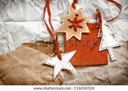 Christmas decoration over grunge paper background/old paper bordering with christmas decoration