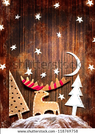 Christmas decoration over grunge wooden background/vintage paper christmas decoration with a  red ribbon - stock photo
