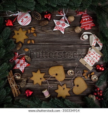 Christmas decoration over the dark wooden background. Place for recipes of christmas cookies