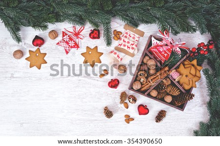 Christmas decoration over the white wooden background. Place for recipes of christmas cookies