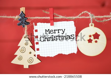 Christmas decoration over wooden background with paper sheet and text Merry Christmas - stock photo