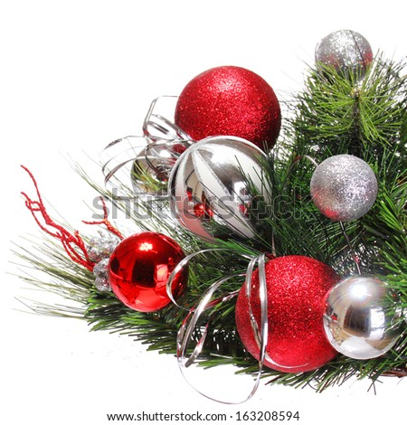 Christmas Decoration. Red and Silver Balls on Christmas tree branch isolated on white background. Holiday Card - stock photo
