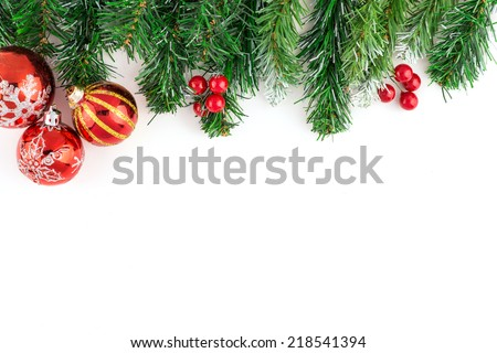 Christmas Decoration. Red and Silver Balls on Christmas tree branch isolated on white background. Holiday Card. - stock photo