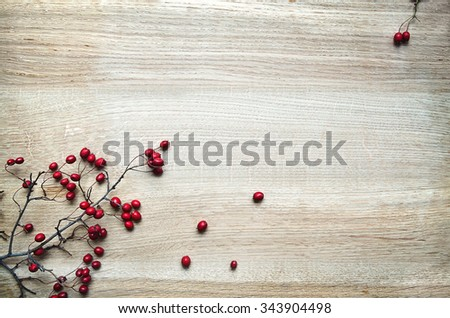 Christmas decoration red berries twig holly on rustic oak wood background with copy-space - stock photo