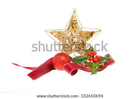 Christmas decoration,red ribbon,gold star, bauble and holly isolated against white - stock photo