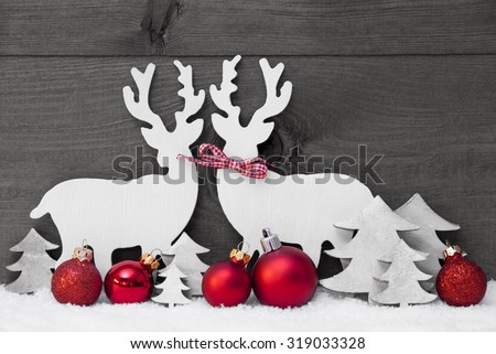 Christmas Decoration, Reindeer Couple In Love On White Snow. Red Ribbon, Christmas Tree, Christmas Ball. Gray, Rustic, Vintage Wooden Background. Christmas Card For Seasons Greetings. Black And White - stock photo