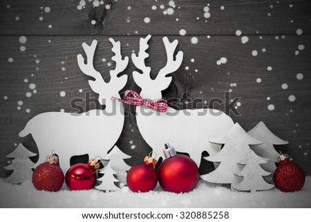 Christmas Decoration, Reindeer Couple In Love On White Snow, Snowflakes. Red Ribbon, Christmas Tree, Ball. Gray Rustic, Vintage Wooden Background. Christmas Card For Seasons Greetings. Black And White - stock photo