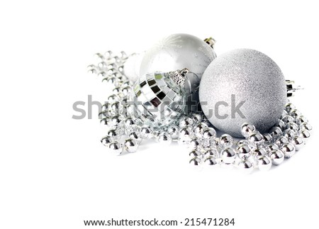 Christmas decoration: silver balls over white background - stock photo