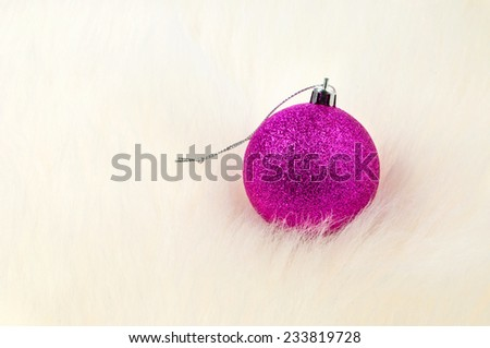 Christmas decoration - Single bauble on top of white fur - stock photo