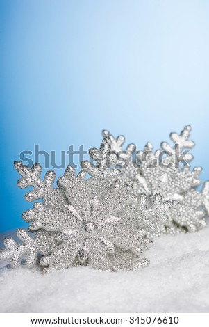 Christmas decoration snowflakes with snow - stock photo