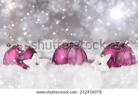 Christmas decoration, three balls on snow with abstract background  - stock photo