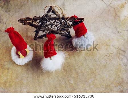 Christmas decoration, three elfs and shape rustic star on abstract background, overhead and copy space