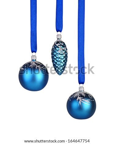 Christmas decoration. Two blue christmas balls and cone hanging on ribbon, white background - stock photo