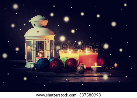 Christmas decoration vintage background, bauble ball and candle with snowflakes effect