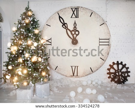 Christmas decoration with a big clock in the interior - stock photo