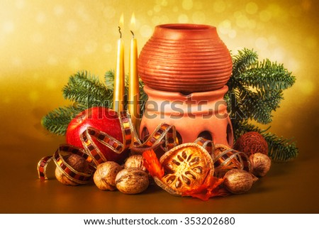 christmas decoration with aroma lamp and candle for advent season on gold background - stock photo