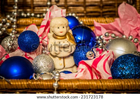 Christmas decoration with balloons in the box on warm background with pretty little angel - stock photo