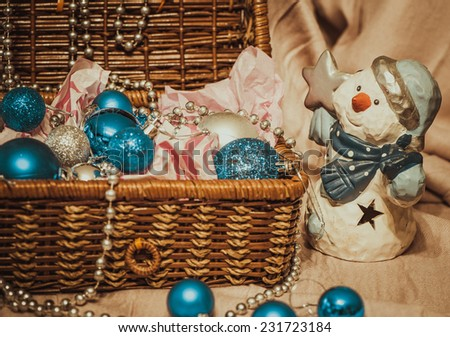 Christmas decoration with balloons in the box on warm background with pretty snowman - stock photo