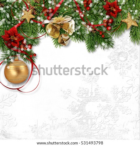 Christmas decoration with bells, holly and poinsettia on white paper