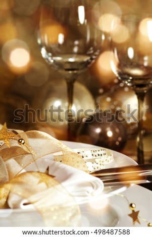 Christmas decoration with bokeh for a festive dinner and wine
