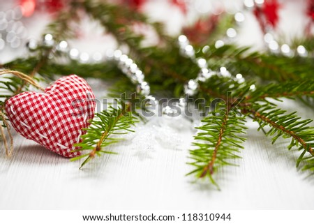 Christmas decoration with branch of Christmas tree and fabric heart - stock photo