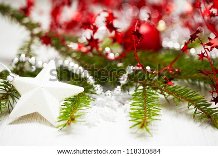 Christmas decoration with branch of Christmas tree and star - stock photo