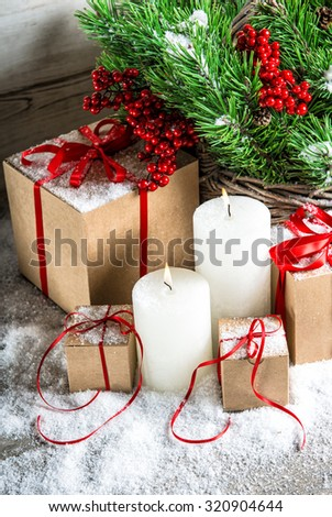 Christmas decoration with burning candles and gift box. Christmas tree branches - stock photo