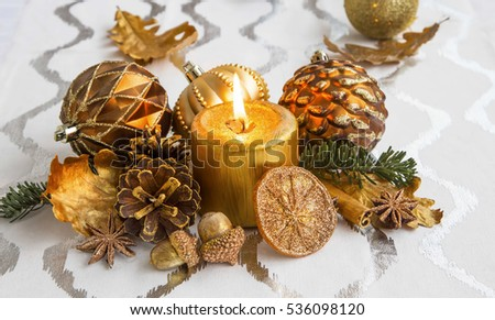 Christmas decoration with candle and ornaments