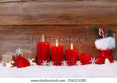 christmas decoration with candles for advent season three candles burning - stock photo