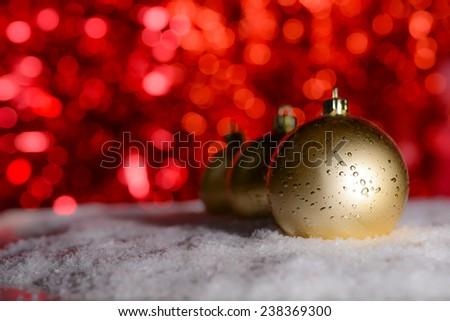 christmas decoration with christmas balls and snow - stock photo