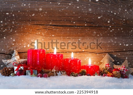 christmas decoration with christmas bauble and candle for advent season four candles burning - stock photo