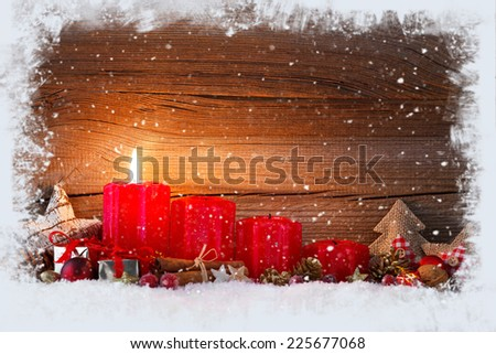 christmas decoration with christmas bauble and candle for advent season one candle burning - stock photo