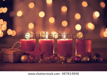 christmas decoration with christmas bauble and candle for advent season three candles burning