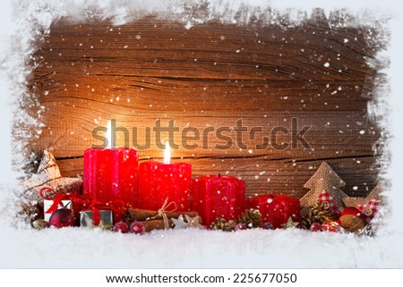 christmas decoration with christmas bauble and candle for advent season two candles burning - stock photo