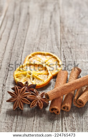 Christmas decoration with cinnamon sticks, anise and orange