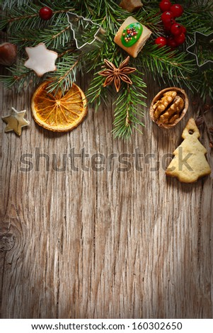 Christmas decoration with cookies and spices on an old wooden background. - stock photo