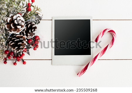 Christmas decoration with decorated picture frame and candy cane - stock photo