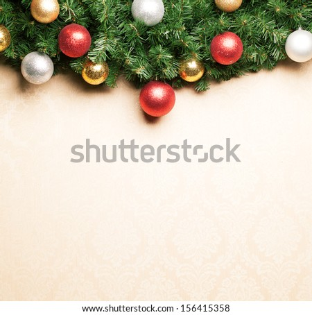 Christmas decoration with fir and baubles on paper. - stock photo
