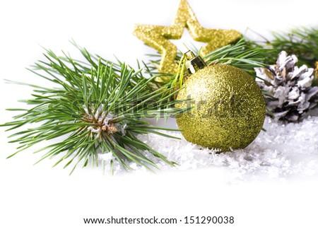 Christmas decoration with fir branch, cone, christmas ball and christmas star, selective focus - stock photo