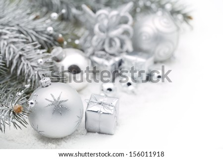 Christmas decoration with fir branch,silver Christmas ball and gift box - stock photo