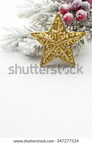Christmas decoration with fir branches on the background of a tree with copy space.