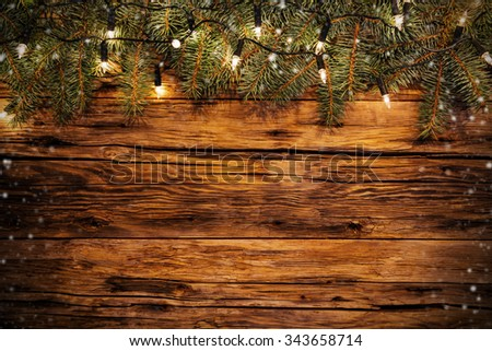 Christmas decoration with fir branches on wooden planks. Copyspace for text - stock photo