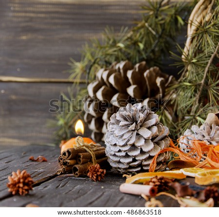 Christmas decoration with fir branches, tangerines, pine cones, and decoration elements , selective focus