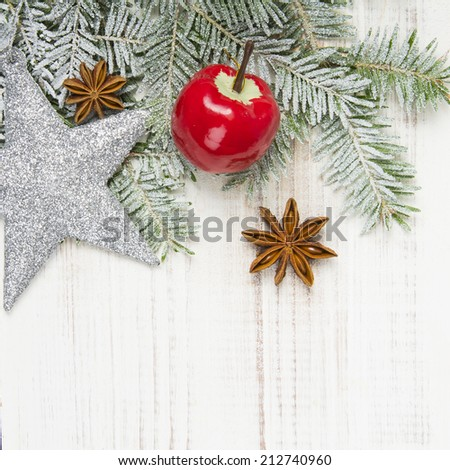 Christmas decoration with fir twigs, baubles, silver stars and artificial snow with a blank space  - stock photo