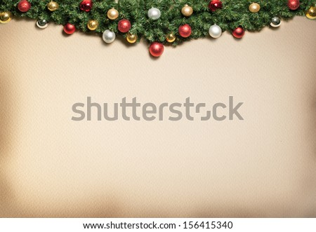Christmas decoration with fur and baubles. - stock photo