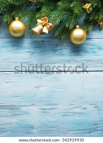 Christmas decoration with fur and baubles on old wood. - stock photo