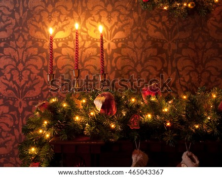 Christmas decoration with garland, tree branch and candles