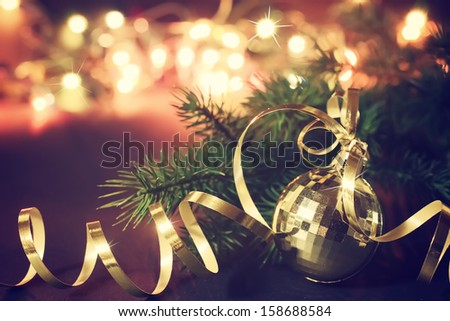 Christmas decoration with golden ball - stock photo