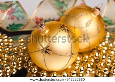Christmas decoration with golden ribbon - stock photo